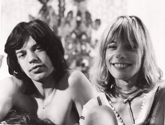 With Mick Jagger...
